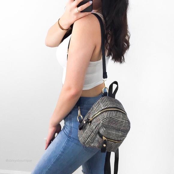 Daisys Boutique Handbags - clueless mini backpack